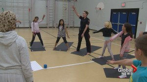 Police poses: veteran constable teaches yoga at Calgary school